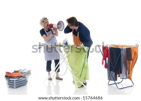 houseman ironing, being shouted at by wife. - stock photo