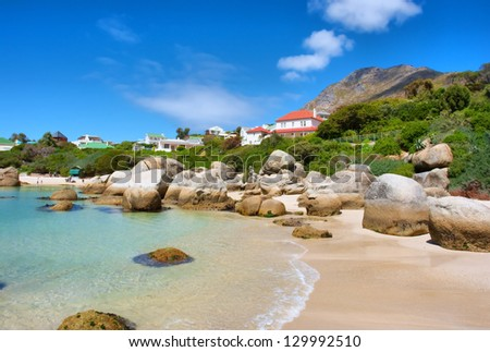 Houses above beach. Shot in the Boulders Beach Nature Reserve, near Cape Town, Western Cape, South Africa. - stock photo