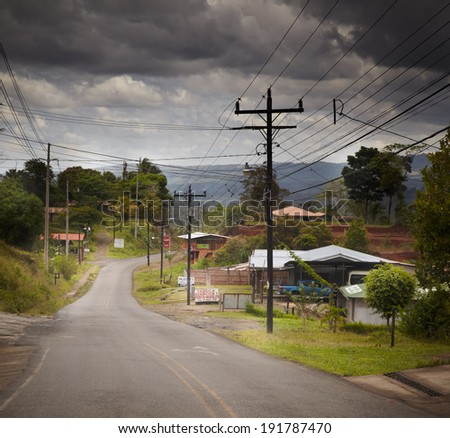 Houses along a road in a village, Costa Rica - stock photo