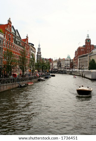 houses along an Amsterdam canal - stock photo
