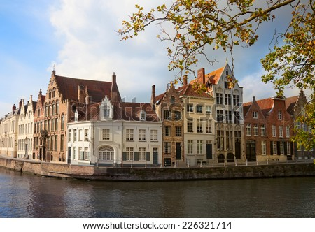 Houses along canal in Bruges, Belgium  - stock photo