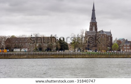 Houses along the bank of river Maas, Maastricht, Netherlands - stock photo