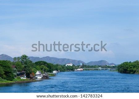 Houses along the river. Residents with waterfront homes. Rivers from the mountains.