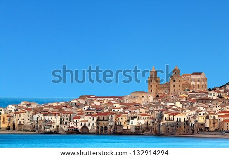 Houses along the shoreline and cathedral in background, Cefalu, Sicily - stock photo