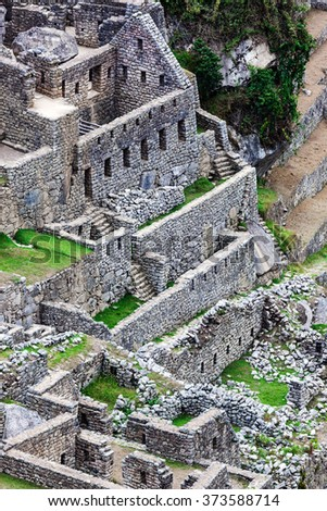 houses and ancient walls to Machu Picchu - stock photo