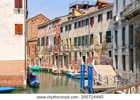 Houses and boats on one of the canals in Venice, Italy