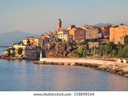 Houses and buildings in the city of Bastia with beautiful colors of dusk - stock photo