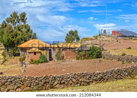 Houses and buildings (with solar panels) on Taquile island at Lake Titicaca in Peru - stock photo