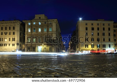 Houses and lanterns on piazza Venezia at summer night in Rome, Italy