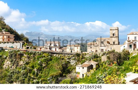 houses and Mother Church (Chiesa Madre) in mountain village Savoca in Sicily, Italy - stock photo