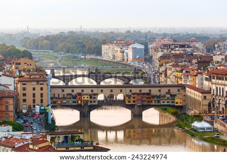 Houses, Arno River and bridges Ponte Vecchio of Florence, Tuscany, Italy - stock photo