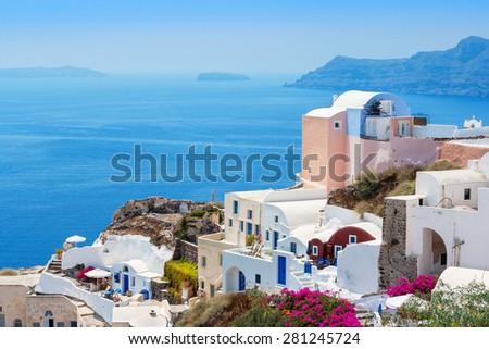 Houses at Oia village and caldera. Santorini island, Cyclades, Greece - stock photo
