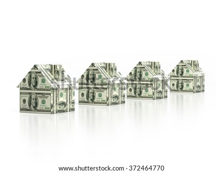 Houses built up with one hundred US dollar bills. Isolated on white background. - stock photo