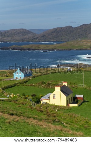 Houses by the ocean at Beara, Ireland - stock photo