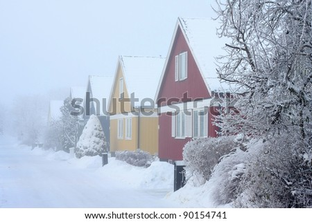 Houses in cold,chilly and frosty winter climate. - stock photo