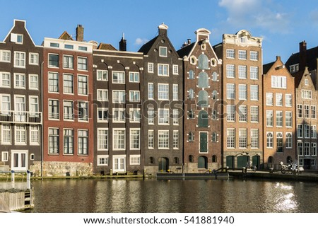 Houses in in a street by a canal in Amsterdam in the Netherlands