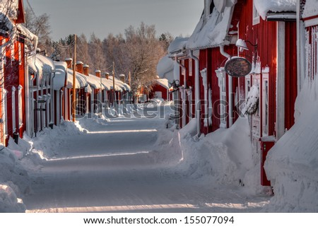 Houses in the snow - stock photo