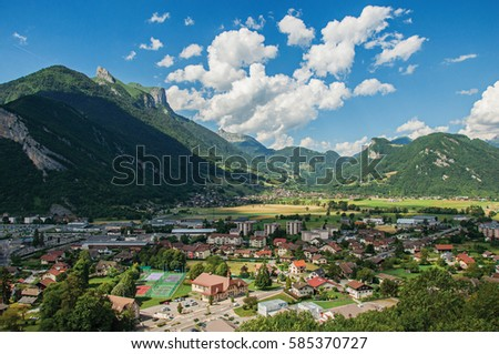Houses in valley with evergreen mountains and blue sky viewed from the Faverges castle's tower. At the charming village of Faverges. Located at the department of Haute-Savoie, south-eastern France.