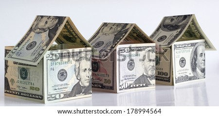 Houses made from dollar banknotes - stock photo