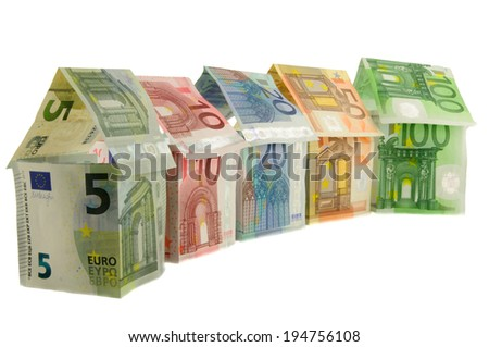 Houses made from euro banknotes, five, ten, twenty, fifty, one hundred - stock photo