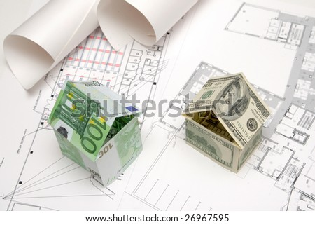 houses made of money, euro and dollars on the blueprint
