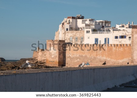 Houses of Essouira, Morocco City on the rocks on the banks of Atlantic ocean. Old houses and medieval fortress. Blue sky.