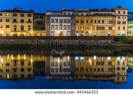 houses of florence reflecting in the arno
