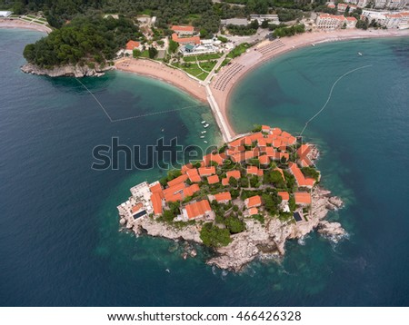 Houses of luxury hotel of Villa Milocer (Aman Resorts) are on the Sveti Stefan rocky island. Aerial view from Adriatic sea. Montenegro