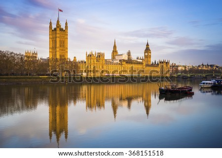 Houses of parliament and Big Ben and Westminster on a sunny early morning - London, UK - stock photo