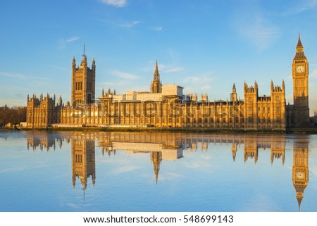 Houses of Parliament and Big Ben with reflection in River Thames on an early morning shot in central London, UK