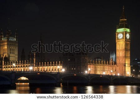 Houses of Parliament, Big Ben and Westminster Bridge at night in London - stock photo