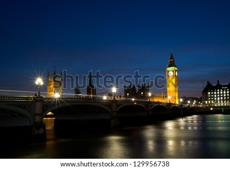 Houses of Parliament on the river thames at dusk - stock photo