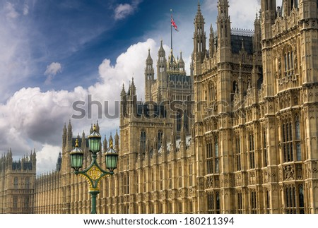Houses of Parliament, Westminster Palace, London gothic architecture. Rectilinear frontal view. - stock photo