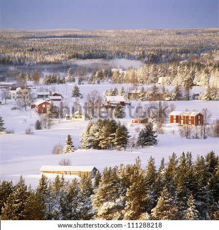 Houses on snow-covered ground, elevated view - stock photo