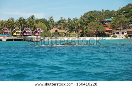 houses on the beach in thailand - stock photo