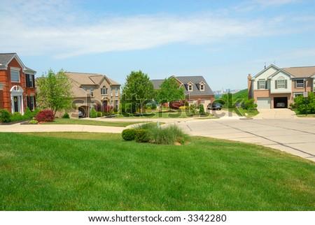 Houses on the cul de sac in a suburban neighborhood in summertime. - stock photo