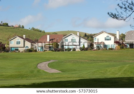 houses on the green - stock photo