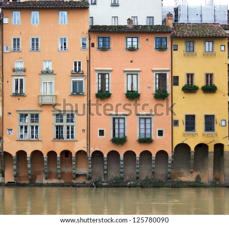 houses on the river Arno in Florence, Italy - stock photo