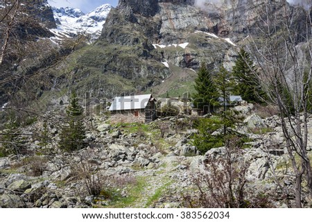Houses on the slope of mountain in National park Ecrins in France