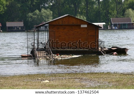 houses on the water, and trash around by the flood - stock photo