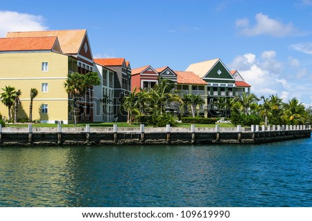 Houses situated around the corner of the harbor. - stock photo