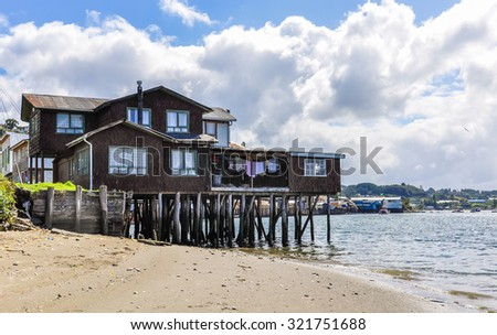 Houses standing on small columns, Chiloe Island, Patagonia, Chile - stock photo