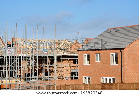 Houses under construction at a modern building site in England, United Kingdom. - stock photo