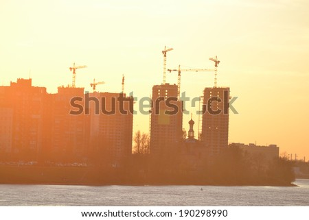 Houses under construction at sunset on the outskirts of St. Petersburg, Russia.