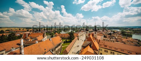 Houses with traditional red roofs in Prague Old Town Square in the Czech Republic - stock photo