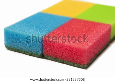 Houseware Concept: Four Colorful Kitchen Sponges Together. Isolated Over White Background. Horizontal Image Orientation - stock photo