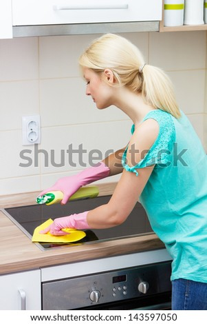 Housewife cleaning in the kitchen. - stock photo
