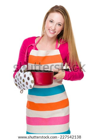 Housewife cooking with saucepan - stock photo