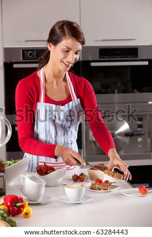 Housewife dividing the cake between the different plates after cutting - stock photo