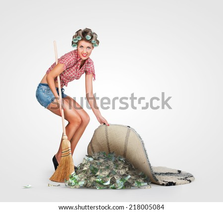 Housewife hiding money - stock photo